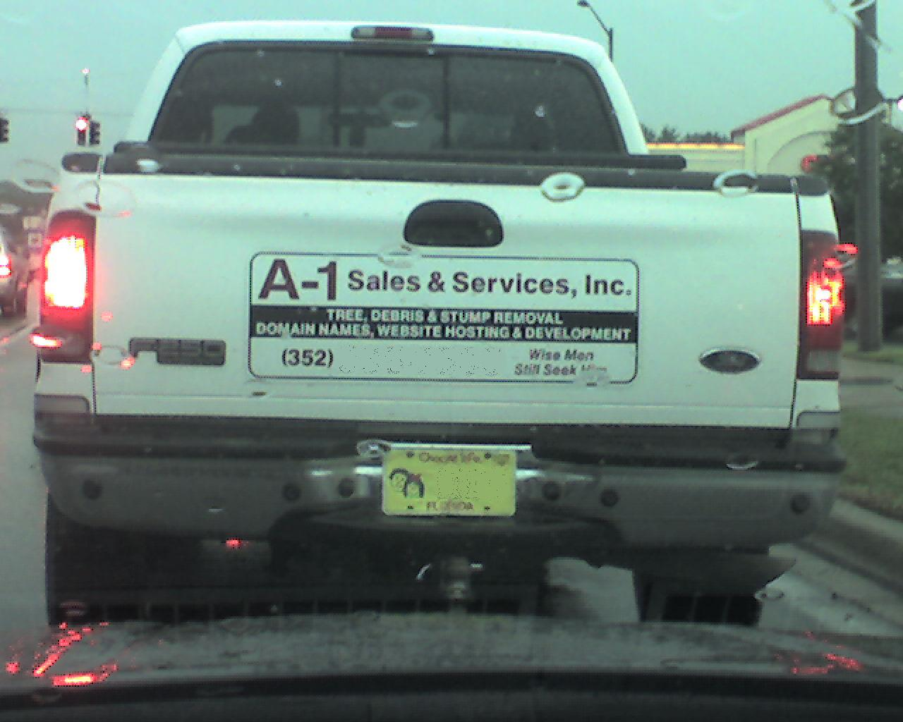 magnet sign on truck: